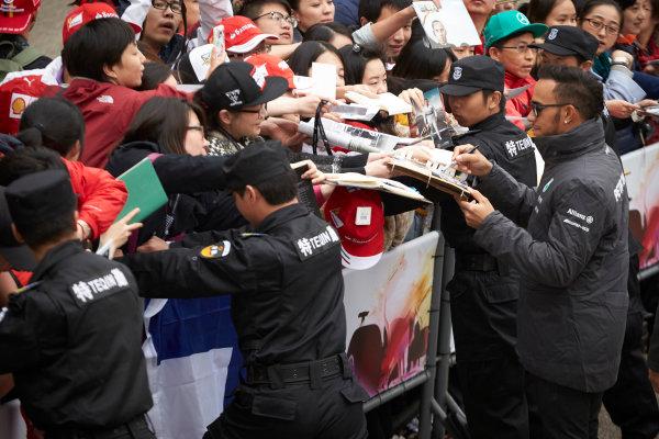 Shanghai International Circuit, Shanghai, China. Thursday 9 April 2015. Lewis Hamilton, Mercedes AMG signs autographs for fans. World Copyright: Steve Etherington/LAT Photographic. ref: Digital Image SNE26861