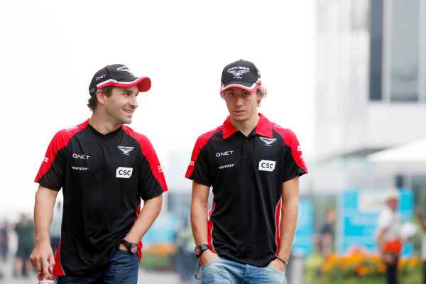 2012 Indian Grand Prix - Friday Buddh International Circuit, New Delhi, India. 26th October 2012. Timo Glock, Marussia F1, with Charles Pic, Marussia F1.  World Copyright:Charles Coates/LAT Photographic ref: Digital Image _N7T2377