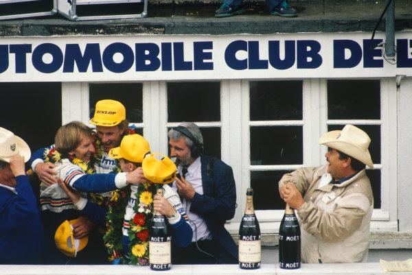 Le Mans, France. 11th - 12th June 1987.Hans-Joachim Stuck/Al Holbert/Derek Bell (Rothmans Porsche 962C), 1st position, podium, portrait. World Copyright: LAT Photographic.Ref: 87LM