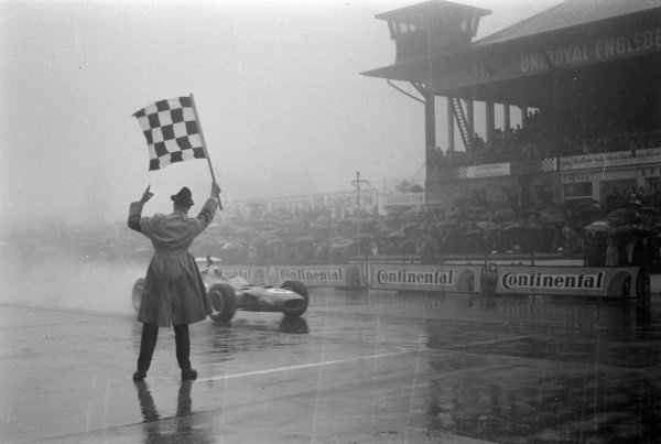 Jackie Stewart, Matra MS10 Ford, takes the chequered flag for victory.