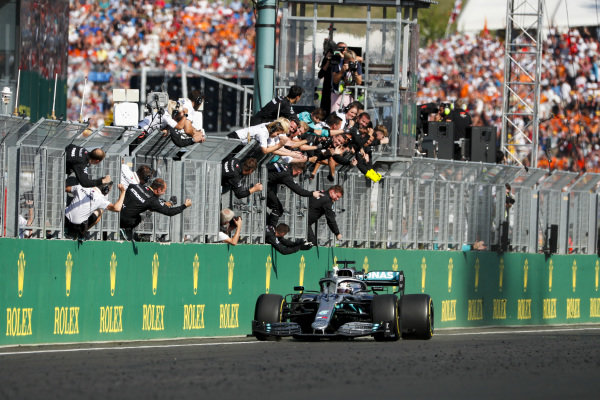 Race winner Lewis Hamilton, Mercedes AMG F1 W10 crosses the finish line