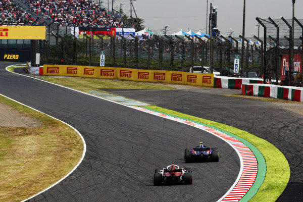 Brendon Hartley, Toro Rosso STR13 Honda, leads Charles Leclerc, Sauber C37 Ferrari
