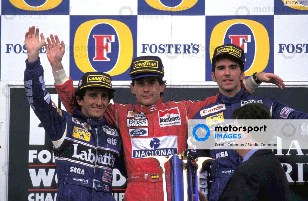 Alain Prost, 2nd position, Ayrton Senna, 1st position, and Damon Hill, 3rd position, on the podium.