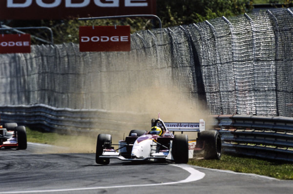 Bruno Junqueira, Newman/Haas Racing, Lola B02/00, tries to correct a slide after going onto the grass.