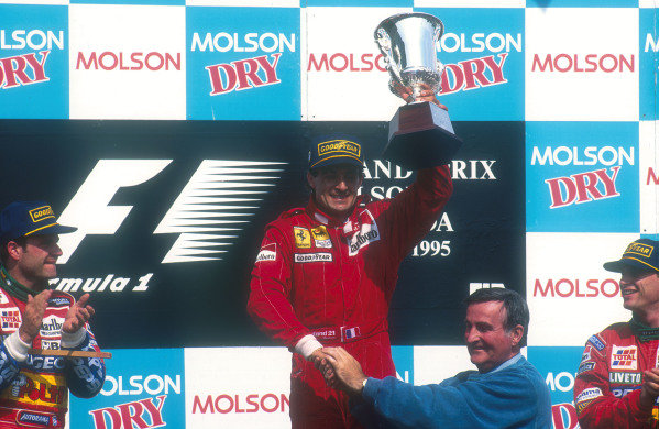 1995 Canadian Grand Prix.Montreal, Quebec, Canada.9-11 June 1995.Jean Alesi (Ferrari 412T2) celebrates 1st position for his maiden Grand Prix win on the podium. Rubens Barrichello, 2nd position and teammate Eddie Irvine 3rd position (both Jordan Peugeot) congratulate him.Ref-95 CAN 19.World Copyright - LAT Photographic