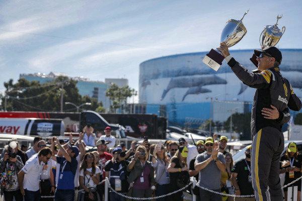 #5 Mustang Sampling Racing Cadillac DPi, DPi: Joao Barbosa, Filipe Albuquerque celebrate on the podium