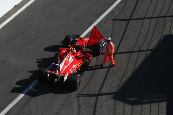 Sochi Autodrom, Sochi, Russia. Friday 28 April 2017. A marshal tries, unsuccessfully, to stop Kimi Raikkonen, Ferrari SF70H, from leaving the pit lane at the end of the session. World Copyright: Coates/LAT Images ref: Digital Image AN7T1180