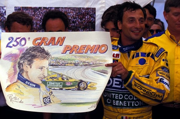 Riccardo Patrese (ITA) Benetton, celebrates his 250th Grand Prix by being presented with a sketch of himself.