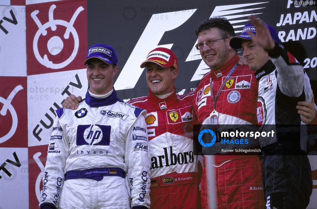 Winner Michael Schumacher on the podium with Ralf Schumacher, 2nd position, Jenson Button, 3rd position and Ross Brawn.