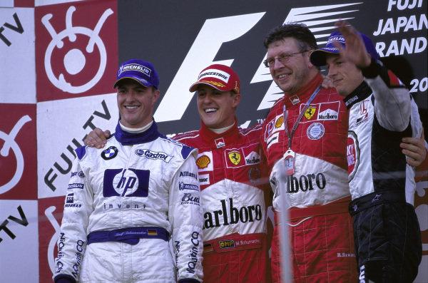 Winner Michael Schumacher on the podium with Ralf Schumacher, 2nd position, Jenson Button, 3rd position and Ross Brawn.