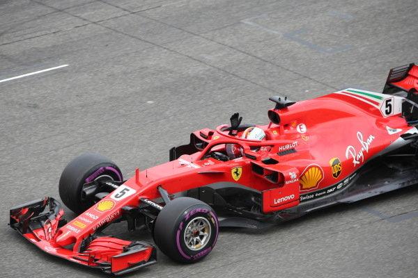 Sebastian Vettel (GER) Ferrari SF-71H celebrates pole position