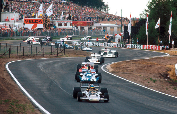 1973 Belgian Grand Prix.Zolder, Belgium.18-20 May 1973.Ronnie Peterson (Lotus 72E Ford) leads Francois Cevert (Tyrrell 006 Ford), Jacky Ickx (Ferrari 312B3), Denny Hulme (McLaren M23 Ford) and Carlos Reutemann (Brabham BT37 Ford) at the start.Ref-73 BEL 71.World Copyright - LAT Photographic
