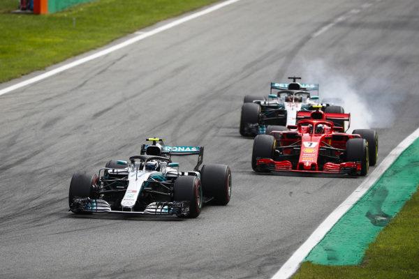Valtteri Bottas, Mercedes AMG F1 W09, leadsKimi Raikkonen, Ferrari SF71H, and Lewis Hamilton, Mercedes AMG F1 W09, as he locks up.