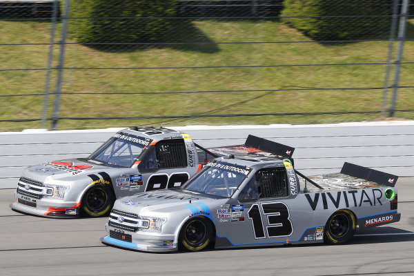 #98: Grant Enfinger, ThorSport Racing, Ford F-150 Protect the Harvest/Curb Records and #13: Johnny Sauter, ThorSport Racing, Ford F-150 Tenda