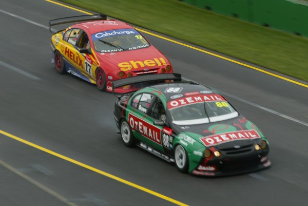 2002 Australian V8 Supercar race.Melbourne, Australia. 3rd March 2002.V8 Supercar 2002 AGP : Ford Falcon driver John Bowe leads Paul Radisich during race 3 of the V8 Supercars at the Foster's Australian GP.World Copyright - Horsburgh/LAT Photographic