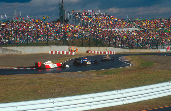 1993 Japanese Grand Prix.Suzuka, Japan.22-24 October 1993.Leader Ayrton Senna (McLaren MP4/8 Ford) comes upto Eddie Irvine (Jordan 193 Hart) and Damon Hill (Williams FW15C Renault) who are fighting over fifth place. Ref-93 JAP 05.World Copyright - LAT Photographic