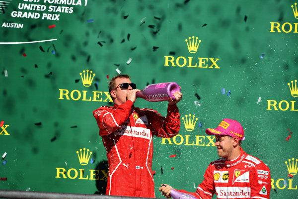 Kimi Raikkonen (FIN) Ferrari and Sebastian Vettel (GER) Ferrari celebrate on the podium with the chmpagne at Formula One World Championship, Rd17, United States Grand Prix, Race, Circuit of the Americas, Austin, Texas, USA, Sunday 22 October 2017. BEST IMAGE