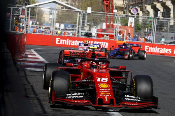Charles Leclerc, Ferrari SF90, Lance Stroll, Racing Point RP19 and Alexander Albon, Toro Rosso STR14