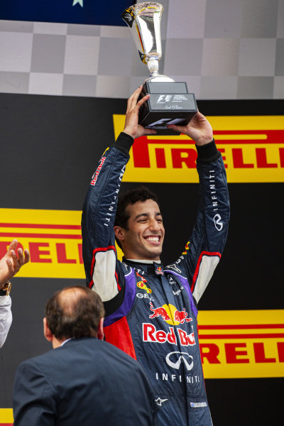 Daniel Ricciardo, 3rd position, celebrates his maiden podium finish proper on the podium.