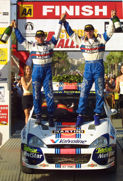 Colin McRae (R) & co-driver Nicky Grist (L) celebrate victory in the Cyprus Rally 2001.Photo:McKlein
