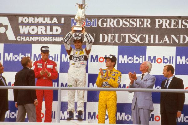 Hockenheim, Germany.24-26 July 1987.Nelson Piquet (Williams Honda) 1st position, Stefan Johansson (McLaren TAG Porsche) 2nd position and Ayrton Senna (Team Lotus) 3rd position on the podium.Ref-87 GER 05.World Copyright - LAT Photographic