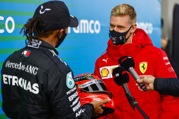 Mick Schumacher presents Lewis Hamilton, Mercedes-AMG Petronas F1, 1st position, with his fathers helmet to commemorate his equal race win record of 91