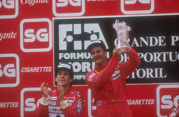 1990 Portuguese Grand Prix.Estoril, Portugal.21-23 September 1990.Nigel Mansell (Ferrari) celebrates 1st position on the podium, with Ayrton Senna (McLaren Honda) 2nd position next to him.Ref-90 POR 02.World Copyright - LAT Photographic