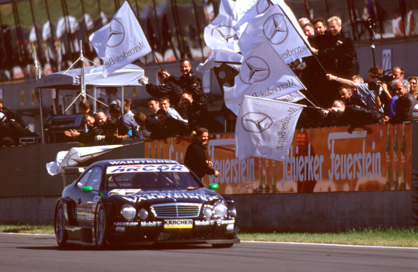 2001 DTM ChampionshipOscersleben, Germany. 19th - 20th May 2001.Race winner Marcel Fassler, AMG Mercedes-Benz CLK, crosses the finish line to the cheers of the team.World Copyright: Peter Spinney/LAT Photographicref: 35mm Image 10