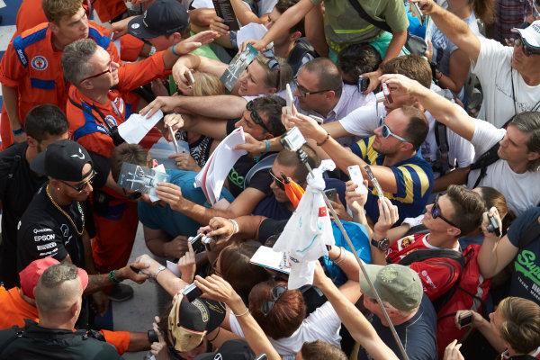 Autodromo Nazionale di Monza, Monza, Italy. Thursday 3 September 2015. Lewis Hamilton, Mercedes AMG, signs autographs for fans. World Copyright: Steve Etherington/LAT Photographic ref: Digital Image SNE23485