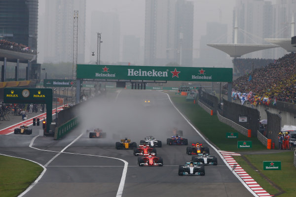 Shanghai International Circuit, Shanghai, China.  Sunday 09 April 2017.  Lewis Hamilton, Mercedes F1 W08 EQ Power+, leads Sebastian Vettel, Ferrari SF70H, Valtteri Bottas, Mercedes F1 W08 EQ Power+, Kimi Raikkonen, Ferrari SF70H, and the rest of the field away at the start. World Copyright: Andrew Hone/LAT Images  ref: Digital Image _ONZ6216