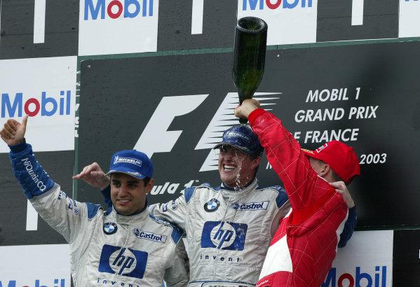 2003 French Grand Prix - Sunday Race,Magny Cours, France. 06th July 2003 Race podium, Ralf Schumacher, BMW Williams FW25, (1st), Juan-Pablo Montoya, (2nd) and Michael Schumacher, Ferrari F2003 GA, (3rd).World Copyright: Steve Etherington/LAT Photographic ref: Digital Image Only