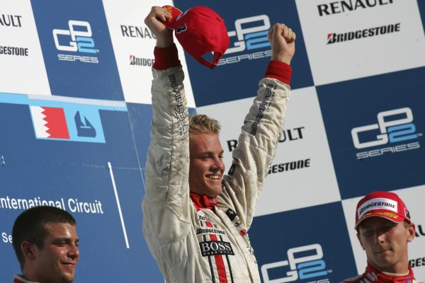 2005 GP2 Series - BahrainSakhir, Bahrain28th-30th September 2005Friday Race 2Nico Rosberg (D, ART Grand Prix) celebrates his victory on the podium with Ernesto Viso (YV, BCN Competicion) and Alexandre Premat (F, ART Grand Prix).Copyright: GP2 Series Media Service ref: Digital Image Only