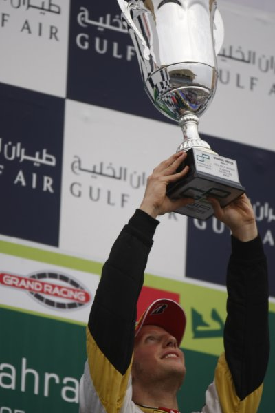 2008 GP2 Asia Series. Saturday Race.Bahrain International Circuit. Sakhir, Bahrain. 5th April. Romain Grosjean (FRA, ART Grand Prix) celebrates victory. World Copyright: Glenn Dunbar/GP2 Series Media Service. Service ref:__O9T0387 jpg
