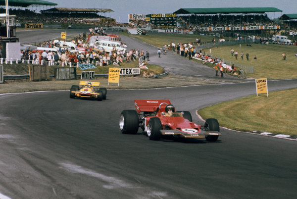 Brands Hatch, England. 16th - 18th July 1970. Jochen Rindt (Lotus 72C-Ford), 1st position, leads Ronnie Peterson (March 701-Ford), 9th position, action.  World Copyright: LAT Photographic. Ref:  70GB21.