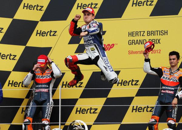 British Grand Prix.  Silverstone, England. 15th-17th June 2012.  Jorge Lorenzo, Yamaha, celebrates on the podium with Casey Stoner and Dani Pedrosa, Honda.  World Copyright: Kevin Wood/LAT Photographic.  ref: Digital Image IMG_8626a