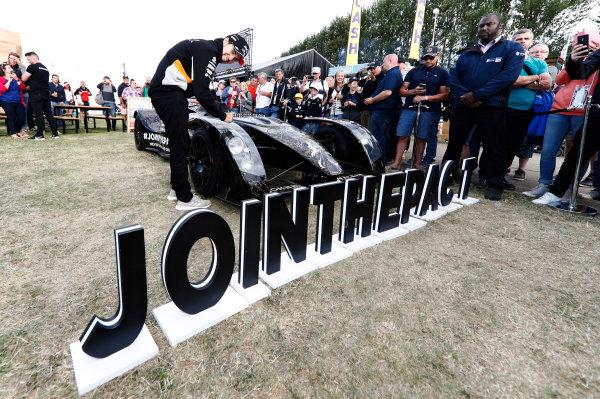 Silverstone, Northamptonshire, UK.  Friday 14 July 2017. Sergio Perez, Force India, poses for a Johnnie Walker promotional event. World Copyright: Glenn Dunbar/LAT Images  ref: Digital Image _31I4239