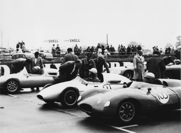 Silverstone, England. 12th July 1958.Tim Parnell (Cooper T46-Climax), 1st position, chats to his father, Reg Parnell on the grid before the start, portrait. World Copyright: LAT Photographic.Ref:  B/WPRINT.