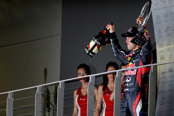 Marina Bay Circuit, Singapore23rd September 2012Sebastian Vettel, Red Bull Racing, 1st position, with his Champagne and trophy.World Copyright: Andy Hone/LAT Photographicref: Digital Image HONY9572