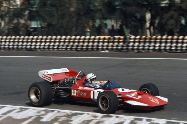 1970 Mexican Grand Prix. Mexico City, Mexico. 23 - 25 October 1970. John Surtees (Surtees TS7A Ford) 8th position, action. World Copyright: LAT Photographic. Ref:  70 MEX 16.