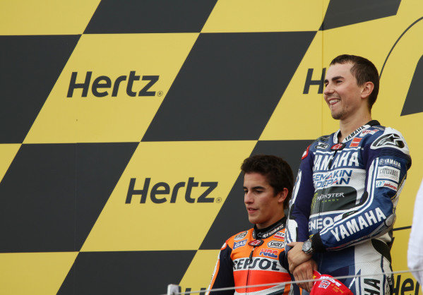 British Grand Prix.  Silverstone, England. 30th August - 1st September 2013.  Jorge Lorenzo, Yamaha, and Marc Marquez, Honda, on the podium.  Ref: IMG_2504a. World copyright: Kevin Wood/LAT Photographic