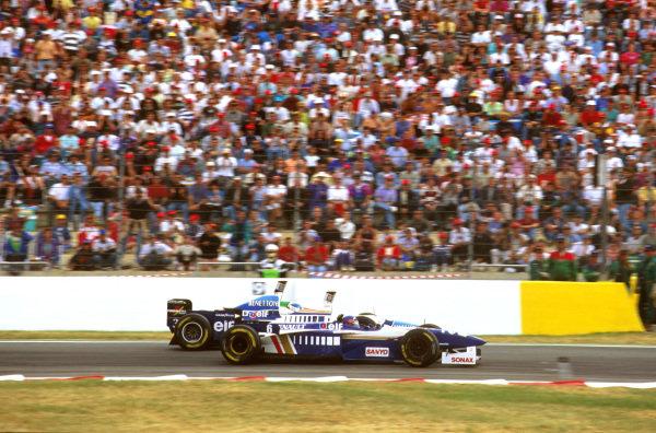 Magny-Cours, France.28-30 June 1996.Jacques Villeneuve (Williams FW18 Renault) passes Jean Alesi (Benetton B196 Renault)Ref-96 FRA 07.World Copyright - LAT Photographic