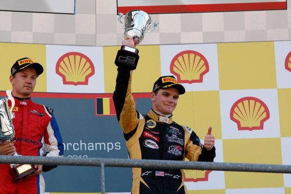 Circuit de Spa-Francorchamps, Spa, Belgium. 2nd September 2012. Sunday Race 2.3rd place Conor Daly (USA, Lotus GP) celebrates on the podium. Portrait. World Copyright: Daniel Kalisz/LAT Photographic Ref: Digital Image _KAL0307.jpg