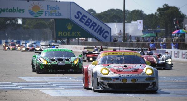 14-19 March 2011. Sebring, Florida USA#045 Flying Lizard Motorsports Porsche 911 GT3 RSR on restart.©2011 Dan R. Boyd LAT Photo USA