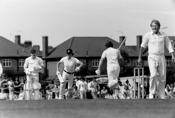 Brands Hatch, Great Britain. 20th July 1974. Rd 10. Ronnie Peterson smashes a four at the annual charity cricket match before the British Grand Prix, whilst wicket keeper, Ian Lavender (Dads Army) and bowler, Ernie Wise, look on, portrait.  World Copyright: LAT Photographic. Ref: L74 - 1314 - 32A.