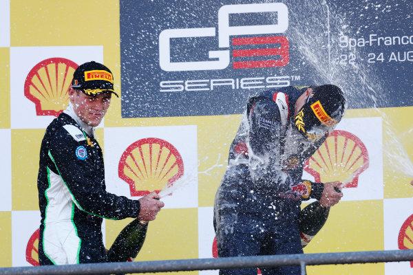 2014 GP3 Series Round 6.  Spa-Francorchamps, Spa, Belgium. Sunday 24 August 2014.  Alex Lynn (GBR, Carlin) celebrates his win on the podium with Richie Stanaway (NZL, Status Grand Prix). Photo: Sam Bloxham/GP3 Series Media Service. ref: Digital Image _SBL7092