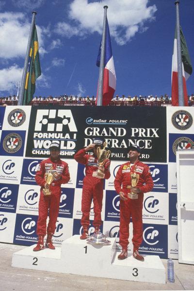 Paul Ricard, Le Castellet, France. 1st - 3rd July 1988. Alain Prost (McLaren MP4/4-Honda), 1st position, celebrates with Ayrton Senna (McLaren MP4/4-Honda), 2nd position and Michele Alboreto (Ferrari F187/88C), 3rd position, on the podium, portrait.  World Copyright: LAT Photographic. Ref: 88FRA 22