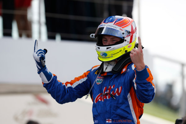 2013 GP2 Series. Round 5. Silverstone, Northamptonshire, England. 30th June. Sunday Race. Jon Lancaster (GBR, Hilmer Motorsport) celebrates his victory.  World Copyright: Alastair Staley/GP2 Series Media Service. Ref: _R6T2488