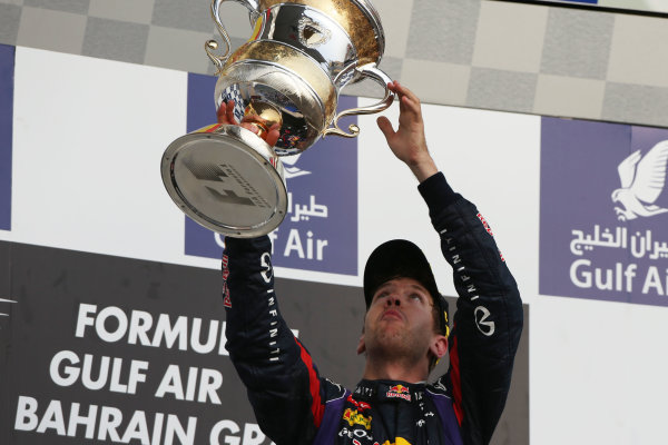 Bahrain International Circuit, Sakhir, Bahrain Sunday 21st April 2013 Sebastian Vettel, Red Bull Racing, 1st position, lifts his trophy. World Copyright: Andy Hone/LAT Photographic ref: Digital Image HONZ3015