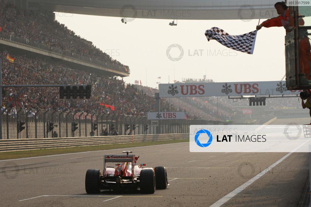 Shanghai International Circuit, Shanghai, China Sunday 14th April 2013 Fernando Alonso, Ferrari F138, 1st position, takes the chequered flag. World Copyright: Andy Hone/LAT Photographic ref: Digital Image HONY7117