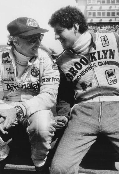 Buenos Aires, Argentina 19th - 21st January 1979. Jody Scheckter (Ferrari 312T3), retired shares a joke with Niki Lauda (Brabham BT48-Alfa), retired, portrait. World Copyright: LAT Photographic. Ref: B/W Print.
